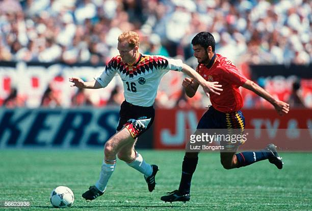 Matthias Sammer of Germany and Josep Guardiola of Spain in action during the World Cup match between Germany and Spain on June 21 1994 in Chcago...