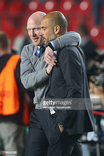 Matthias Sammer , sporting director of Bayern Muenchen celebrates with head coach Pep Guardiola after winning the UEFA Super Cup between FC Bayern...
