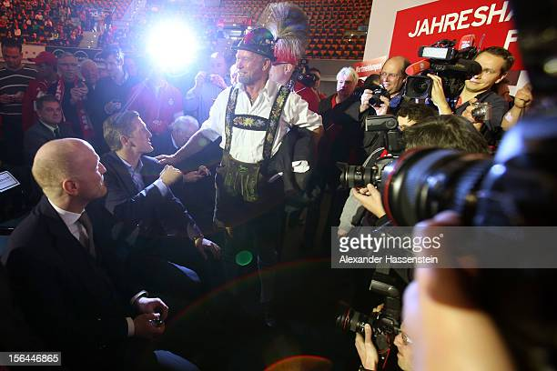 Matthias Sammer Sporting director of FC Bayern Muenchen and Bastain Schweinsteiger welcomes a supporter prior the FC Bayern Muenchen general meeting...