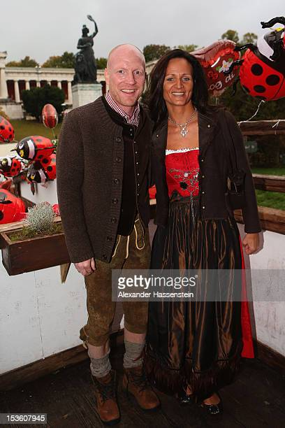 Matthias Sammer sporting director of FC Bayern Muenchen attends with his wife Karin Sammer the Oktoberfest beer festival at the Kaefer Wiesnschaenke...