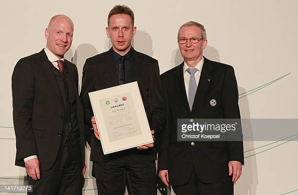 Matthias Sammer sporting director of the German Football Association Joerg Heinrich who presents his football coach licence and Rainer Milkoreit...