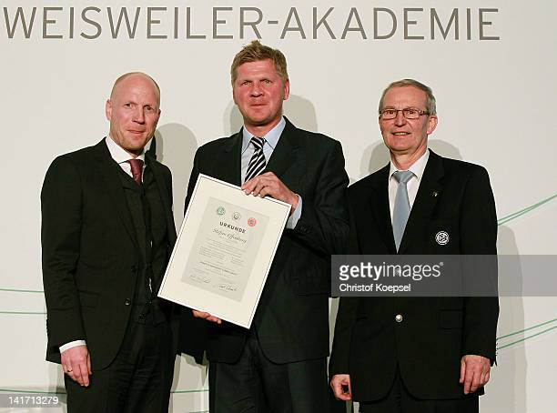 Matthias Sammer sporting director of the German Football Association Stefan Effenberg who presents his football coach licence and Rainer Milkoreit...