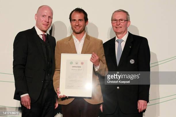 Matthias Sammer, sporting director of the German Football Association, Mehmet Scholl who presents his football coach licence and Rainer Milkoreit,...