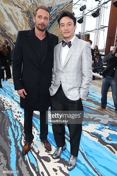 Matthias Schoenaerts and Chang Chen attend the Louis Vuitton Menswear Fall/Winter 20142015 Show as part of Paris Fashion Week on January 16 2014 in...