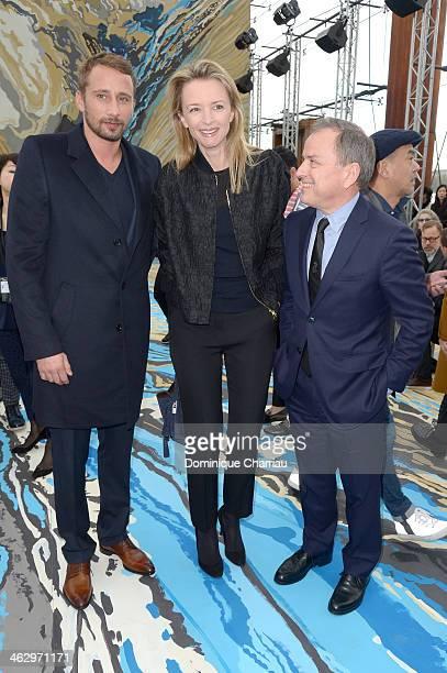 Matthias Schoenaerts Delphine Arnault and Michael Burke attend the Louis Vuitton Menswear Fall/Winter 20142015 Show as part of Paris Fashion Week on...