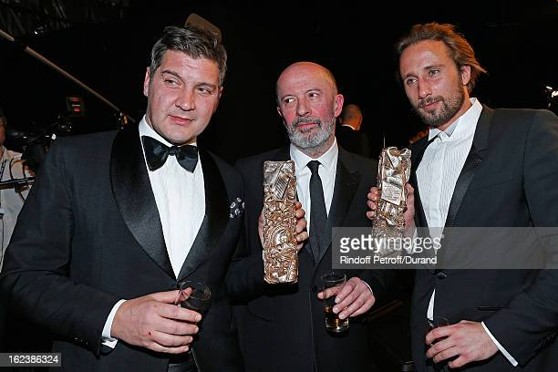 Matthias Schoenaerts holding his Cesar award for best young actor director Jacques Audiard and screenwriter Thomas Bidegain holding his Cesar award...