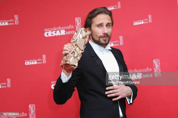 Matthias Schoenaerts poses with his trophy after receiving the Best Newcomer Actor award during the Cesar Film Awards 2013 at Theatre du Chatelet on...