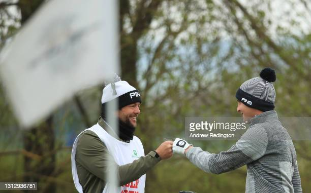 Matthias Schwab of Austria celebrates with his caddie James Baker after holing his third shot from a bunker on the 9th hole during Day Three of the...