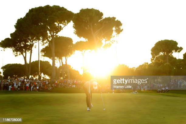 Matthias Schwab of Austria collects his ball from the hole on the eighteenth green after the first playoff hole during Day Four of the Turkish...