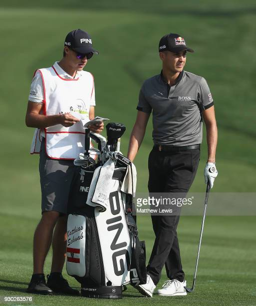Matthias Schwab of Austria looks on with his caddie during day four of the Hero Indian Open at Dlf Golf and Country Club on March 11 2018 in New...