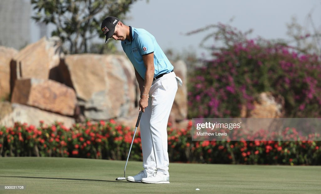 Matthias Schwab of Austria makes a putt on the 17th green during day three of the Hero Indian Open at Dlf Golf and Country Club on March 10, 2018 in New Delhi, India.