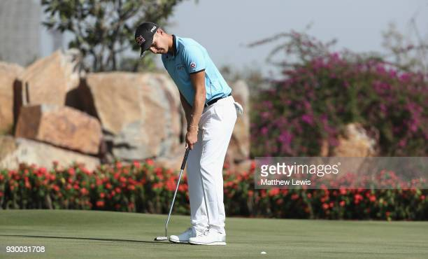 Matthias Schwab of Austria makes a putt on the 17th green during day three of the Hero Indian Open at Dlf Golf and Country Club on March 10 2018 in...