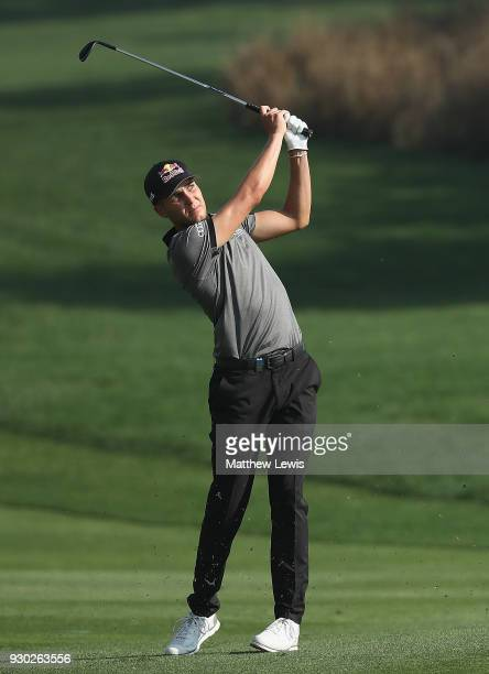 Matthias Schwab of Austria plays is second shot on the 2nd fairway during day four of the Hero Indian Open at Dlf Golf and Country Club on March 11...