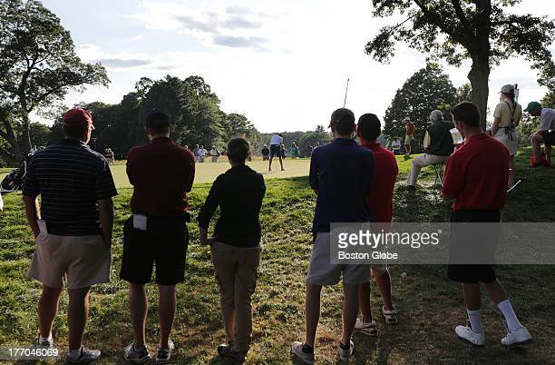 Matthias Schwab putting on the 14th green as the gallery watches during the US Amateur third round of match play at The Country Club in Brookline