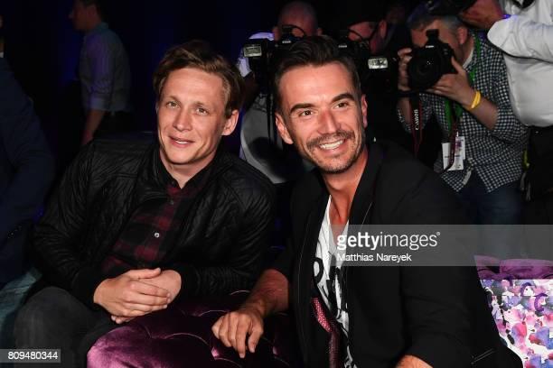 Matthias Schweighoefer and Florian Silbereisen attend the Guido Maria Kretschmer Fashion Show Autumn/Winter 2017 at Tempodrom on July 5 2017 in...