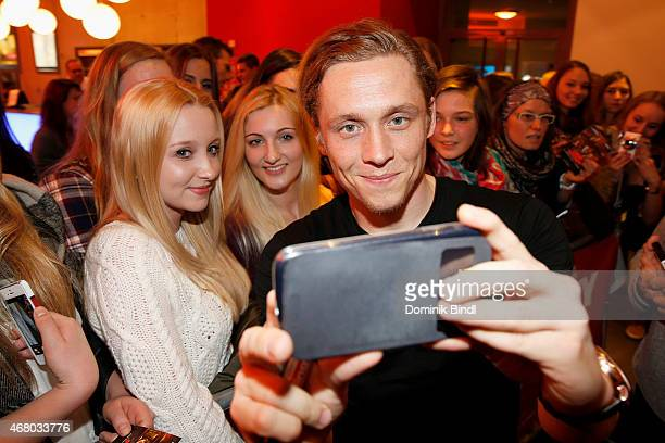 Matthias Schweighoefer shots a selfie with a fan during the 'The Nanny' Munich presentation at Mathaeser Filmpalast on March 29 2015 in Munich Germany