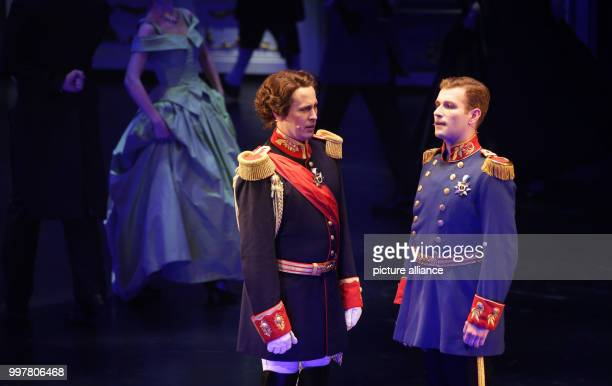 Matthias Stockinger as King Ludwig II and Julian Wejwar as Prince Otto on stage during the premiere of the musical 'Ludwig II' in Fuessen, Germany, 3...
