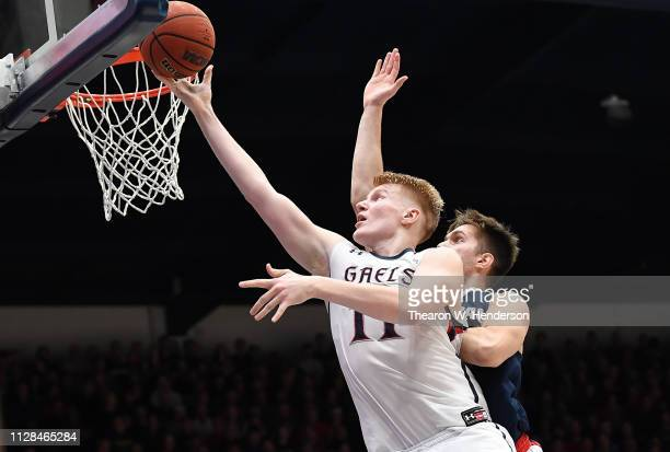 Matthias Tass of the Saint Mary's Gaels goes in for a layup against the Gonzaga Bulldogs during the second half of their NCAA college basketball game...