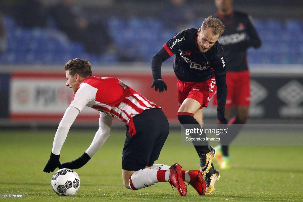 Matthias Verreth of PSV U23, Jason Bourdouxhe of Helmond Sport during the Dutch Jupiler League match between PSV U23 v Helmond Sport at the De Herdgang on January 12, 2018 in Eindhoven Netherlands