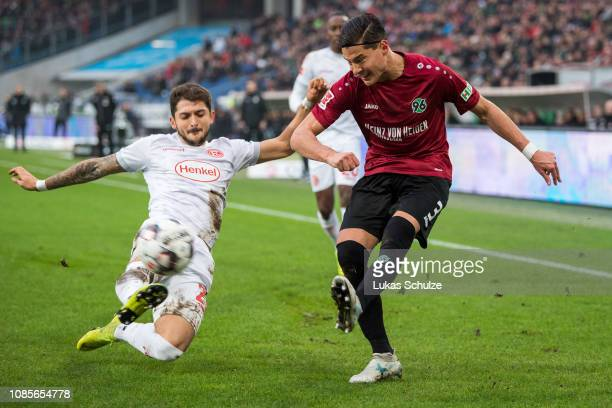 Matthias Zimmermann of Düsseldorf challenges for the ball with Miiko Albornoz of Hannover during the Bundesliga match between Hannover 96 and Fortuna...