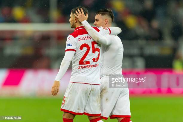 Matthias Zimmermann of Fortuna Duesseldorf and Erik Thommy of Fortuna Duesseldorf celebrates during the Bundesliga match between Fortuna Duesseldorf...