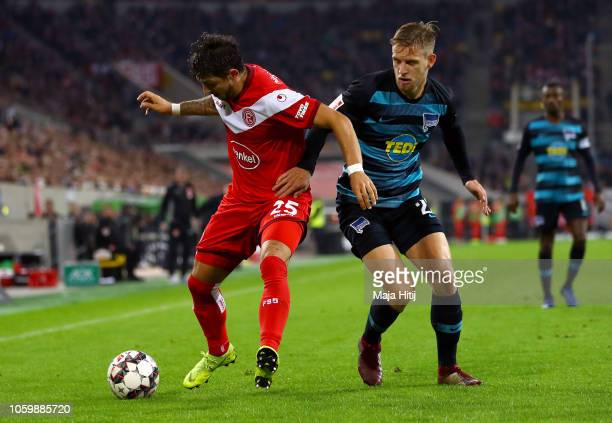 Matthias Zimmermann of Fortuna Duesseldorf battles for possession with Arne Maier of Hertha BSC during the Bundesliga match between Fortuna...