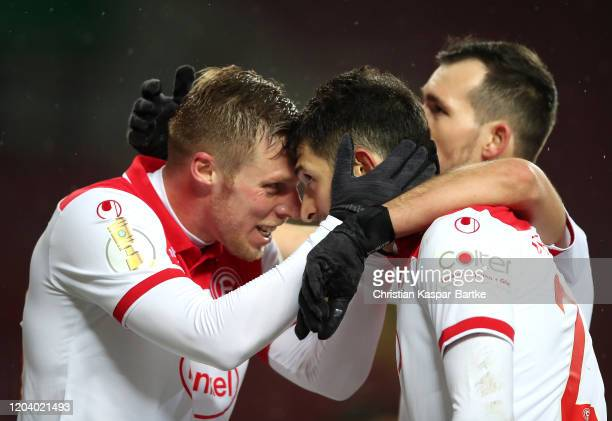 Matthias Zimmermann of Fortuna Dusseldorf celebrates with Rouwen Hennings after scoring his team's third goal during the DFB Cup round of sixteen...