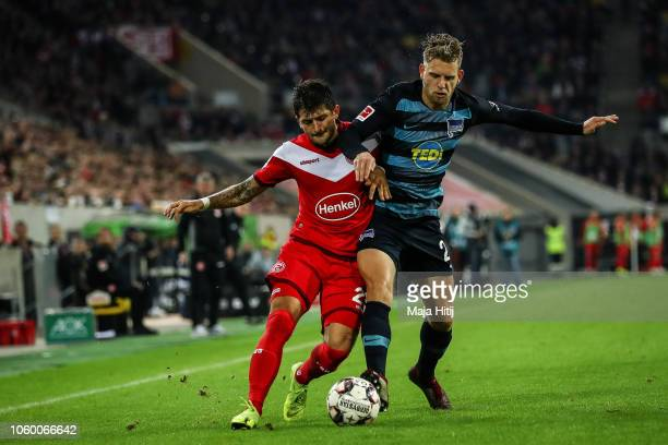 Matthias Zimmermann of Fortuna Dusseldorf is challenged by Arne Maier of Hertha Berlin during the Bundesliga match between Fortuna Duesseldorf and...