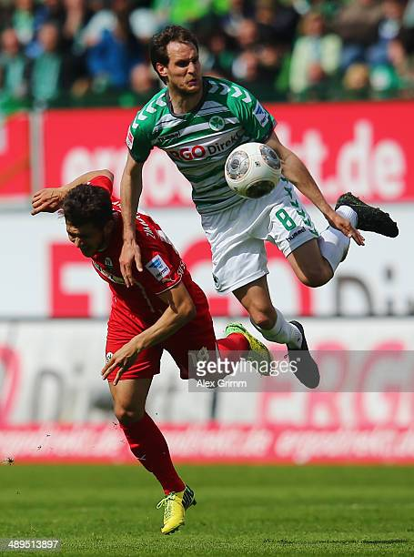 Matthias Zimmermann of Sandhausen is challenged by Stephan Fuerstner of Greuther Fuerth during the Second Bundesliga match between Greuther Fuerth...