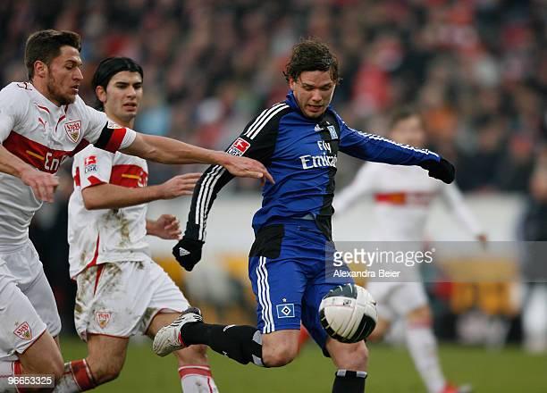 Matthieu Delpierre and Serdar Tasci of VfB Stuttgart miss to stop Marcus Berg of Hamburger SV scoring his first goal during the Bundesliga first...