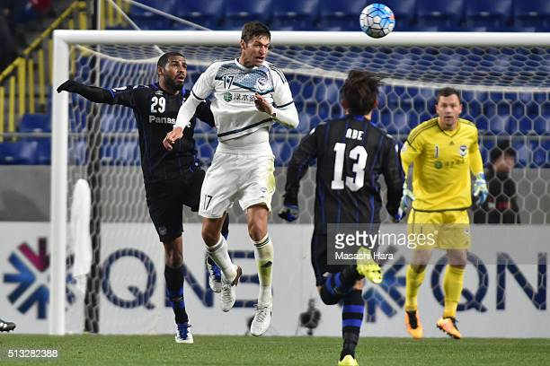 Matthieu Delpierre of Melbourne Victory and Patric of Gamba Osaka compete for the ball during the AFC Champions League Group G match between Gamba...
