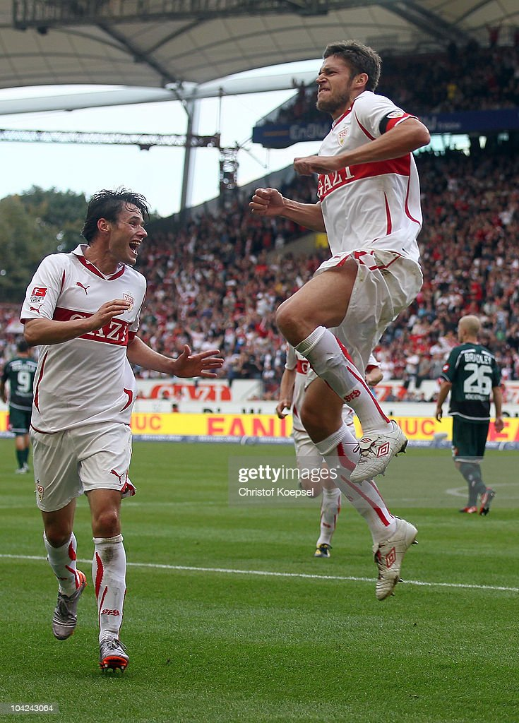 Matthieu Delpierre of Stuttgart (R) celebrates the sixth goal with Christian Traesch of Stuttgart (L) during the Bundesliga match between VfB Stuttgart and Borussia Moenchengladbach at Mercedes-Benz Arena on September 18, 2010 in Stuttgart, Germany.