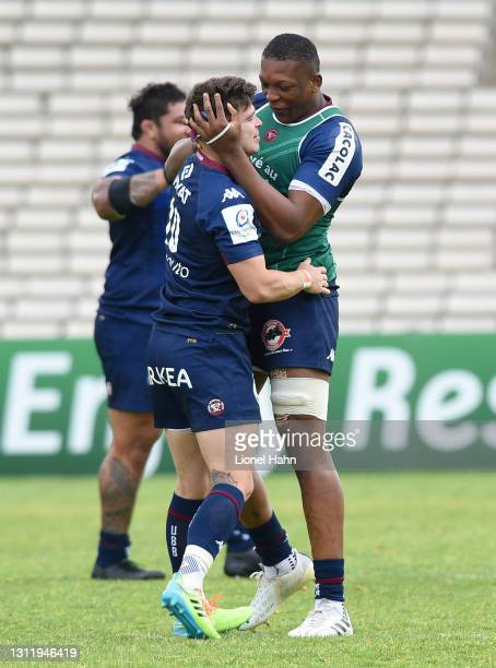 Matthieu Jalibert of Bordeaux-Begles celebrates with Cameron Woki after kicking a drop goal to win the game during the Heineken Champions Cup -...