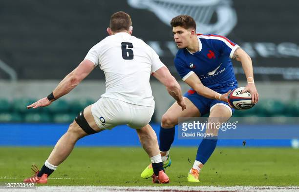 Matthieu Jalibert of France passes the ball watched by Mark Wilson during the Guinness Six Nations match between England and France at Twickenham...