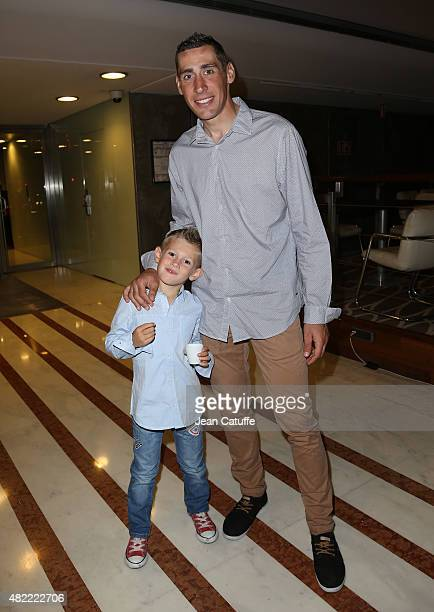 Matthieu Ladagnous of France and Team FDJ and his son Theo Ladagnous leave their hotel for the team's party following stage twenty one of the 2015...
