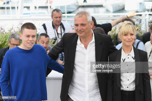 Matthieu Lucci Laurent Cantet and Marina Fois attend the 'L'Atelier' photocall during the 70th annual Cannes Film Festival at Palais des Festivals on...