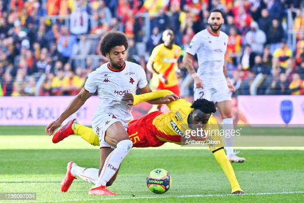 Matthieu UDOL of Metz and Arnaud KALIMUENDO of Rc Lens during the Ligue 1 Uber Eats match between Lens and Metz at Stade Bollaert-Delelis on October...
