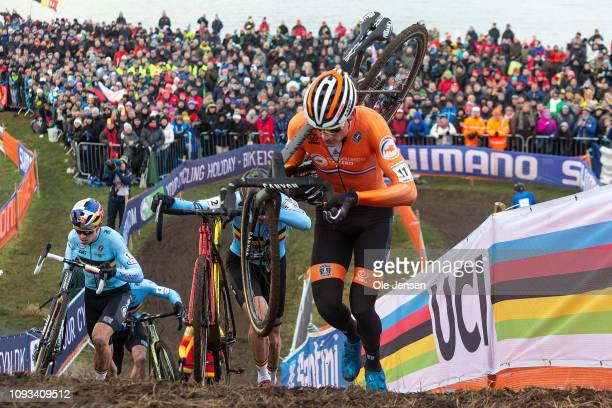 Matthieu van der Poel of Holland has taken the lead and is closely followed uphill by Toon Aerst and Wout van Aert both of Belgium during the 2019...