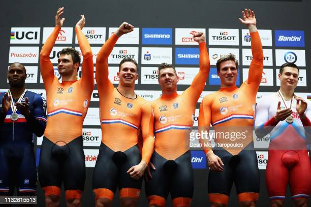 Matthijs Buchli Roy van den Berg Harrie Lavreysen and Jeffrey Hoogland of the Netherlands pose for a selfie after they win gold in the Men's team...