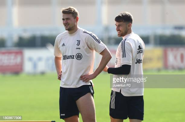 Matthijs de Ligt and Aaron Ramsey of Juventus FC look on during Juventus FC training session at JTC on February 24, 2021 in Turin, Italy.