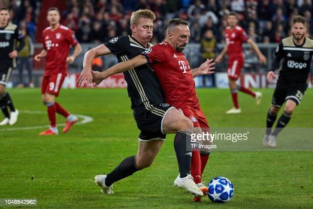 Matthijs de Ligt of Ajax Amsterdam and Franck Ribery of Bayern Muenchen battle for the ball during the Group A match of the UEFA Champions League...