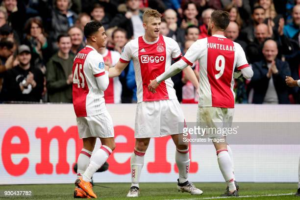 Matthijs de Ligt of Ajax celebrates 10 with Justin Kluivert of Ajax Klaas Jan Huntelaar of Ajax during the Dutch Eredivisie match between Ajax v SC...