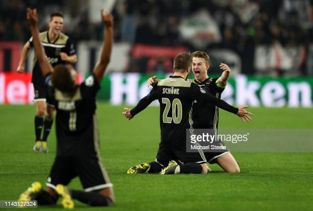Matthijs de Ligt of Ajax celebrates victory with Lasse Schone of Ajax during the UEFA Champions League Quarter Final second leg match between...