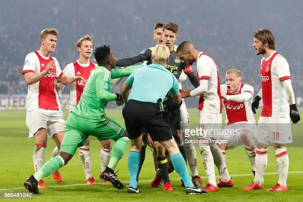 Matthijs de Ligt of Ajax Frenkie de Jong of Ajax Andre Onana of Ajax Marco van Ginkel of PSV Hakim Ziyech of Ajax Referee Kevin Blom Donny van de...