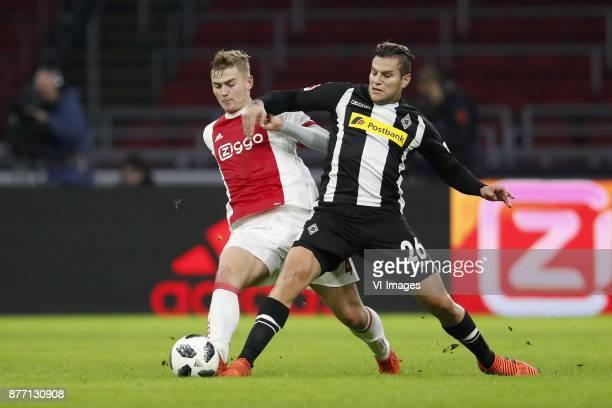 Matthijs de Ligt of Ajax Raul Bobadilla of Borussia Monchengladbach during the international friendly match between Ajax Amsterdam and Borussia...