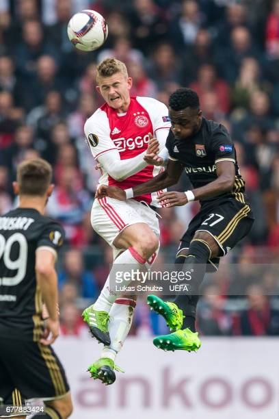 Matthijs de Ligt of Amsterdam is challenged by Maxwel Cornet of Lyon during the Uefa Europa League semi final first leg match between Ajax Amsterdam...