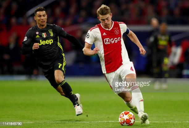 Matthijs de Ligt of Amsterdam runs with the ball next to Cristiano Ronaldo during the UEFA Champions League Quarter Final first leg match between...