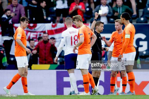 Matthijs de Ligt of Holland receives a yellow card from referee Clement Turpin during the UEFA Nations league match between Holland v England at the...
