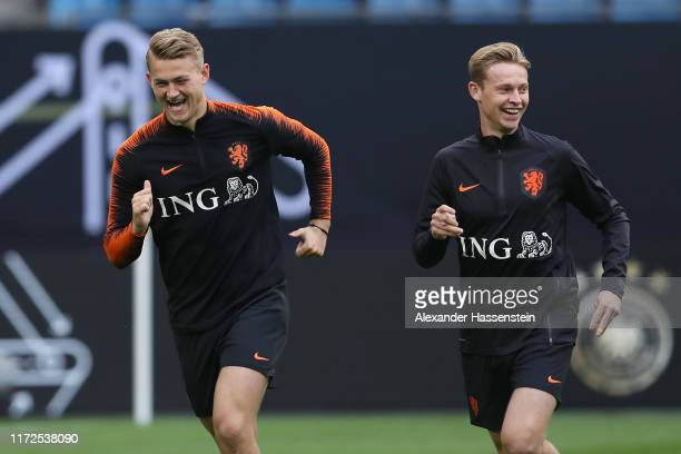 Matthijs de Ligt of Holland smiles with his team mate Frenkie de Jong during a training session of the Netherlands national team prior to the UEFA...