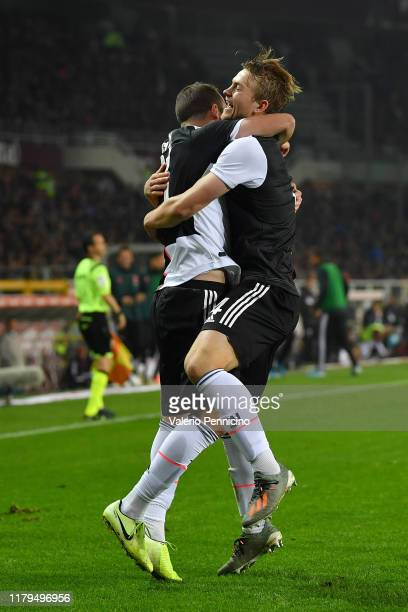 Matthijs de Ligt of Juventus celebrates after scored the opening goal with team mate Gonzalo Higua'n during the Serie A match between Torino FC and...